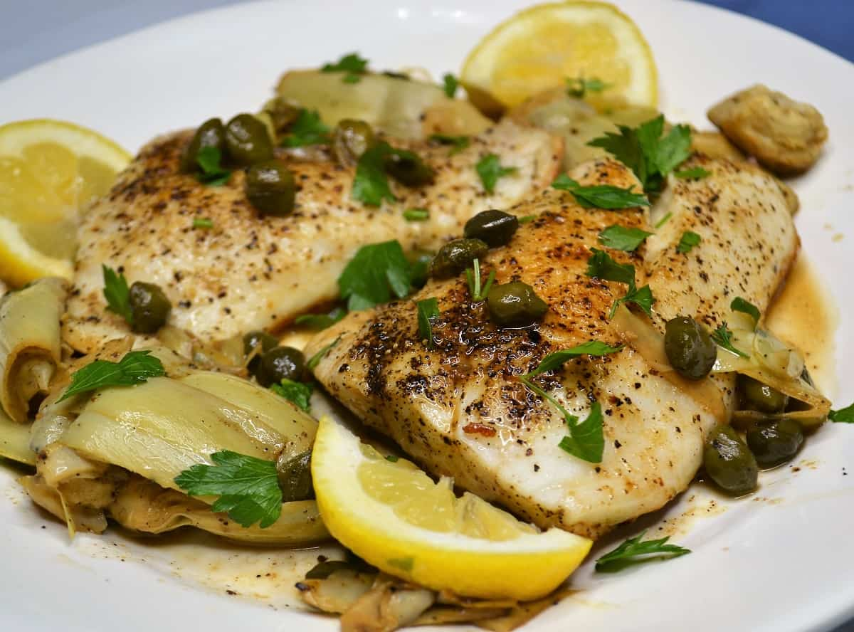 Easy cod piccata with capers and lemons on a plate