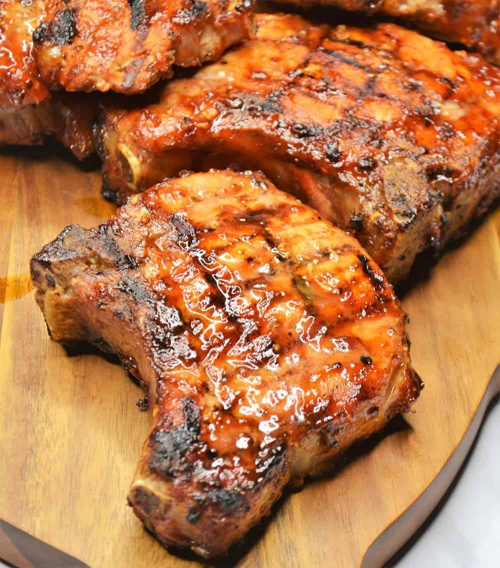 juicy grilled pork chops on a cutting board