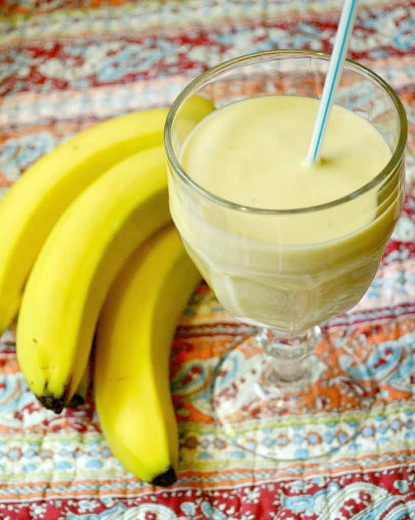 Tropical Banana Smoothie in a glass next to bananas