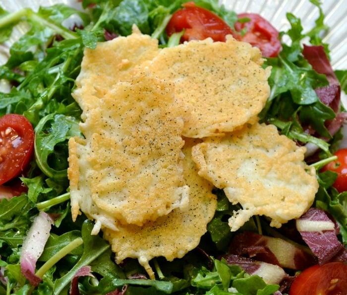 parmesan crisps on top of salad