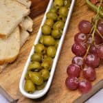 olive, grapes and bread board