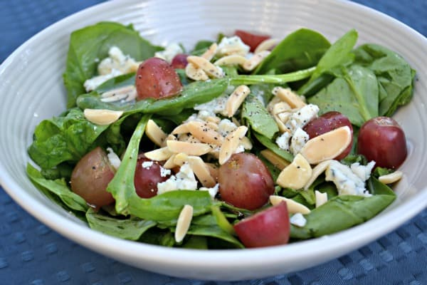 bowl of spinach salad with blue cheese