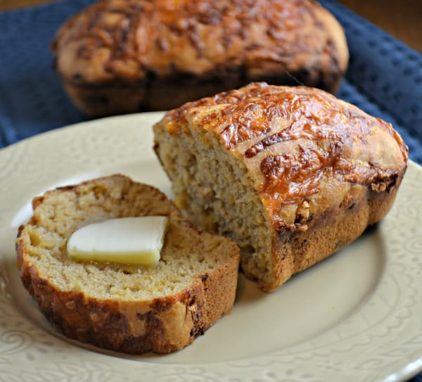 Cheesy Beer Bread on a plate with butter