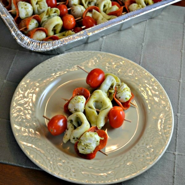Pesto Tortellini Skewers are easy to make and easy to transport. These skewer appetizers are perfect to bring to a party.