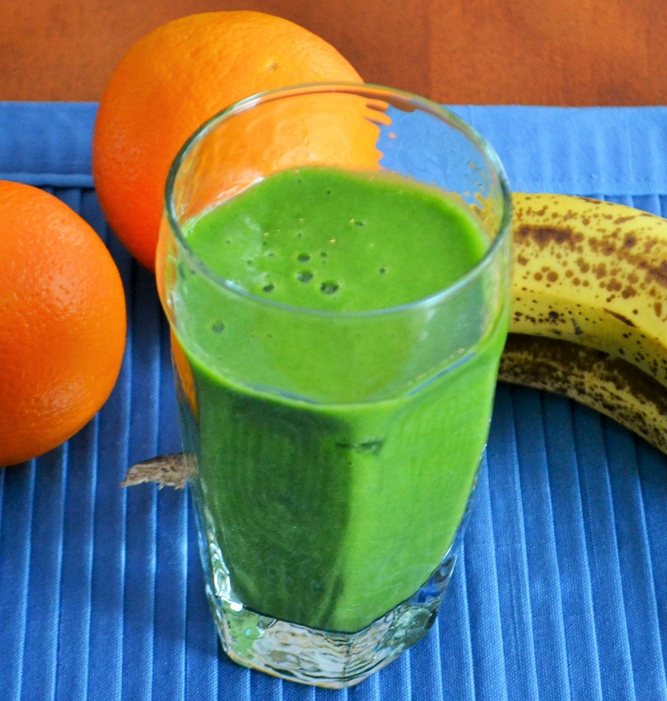 I love the bright green color of this orange banana smoothie with spinach.