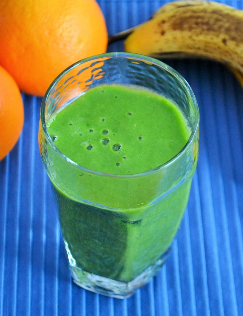 A smoothie  with orange, banana and spinach is perfect for breakfast!
