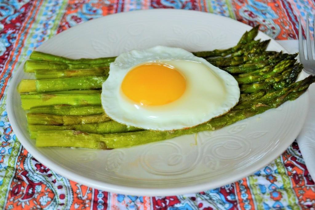 asparagus and eggs on a plate