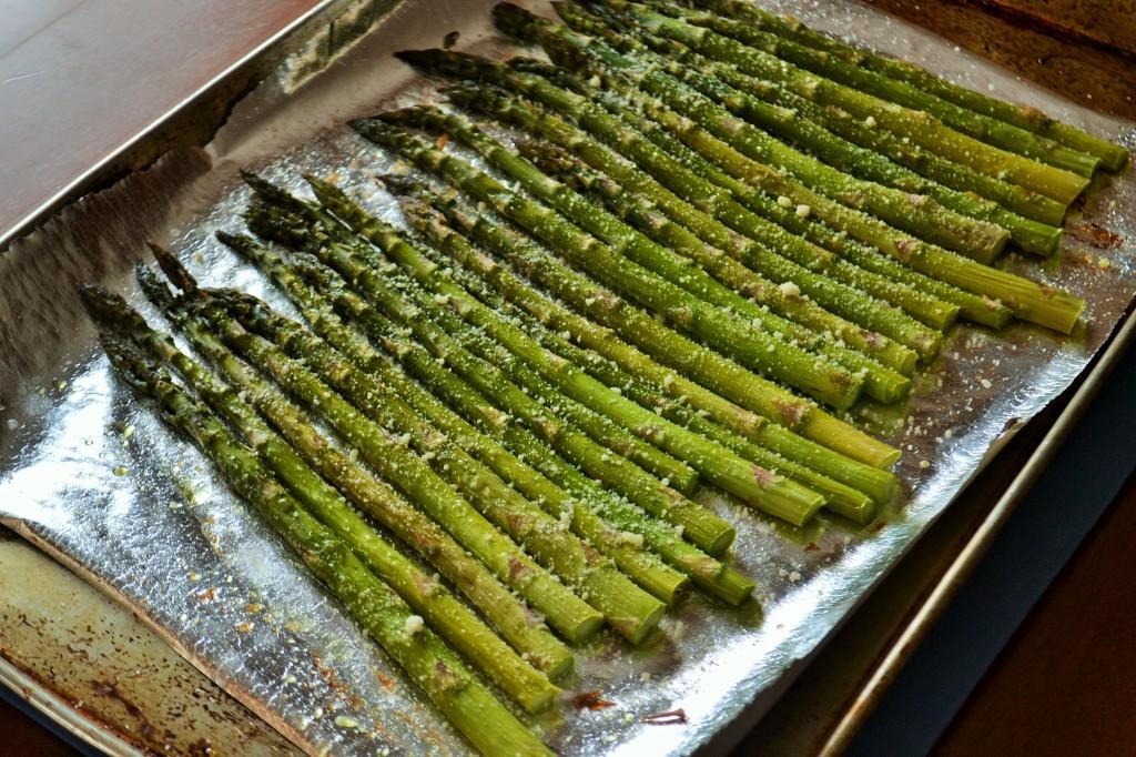 Parmesan asparagus on a pan ready to roast