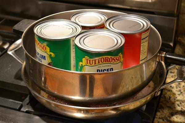 a pan with 4 cans in it