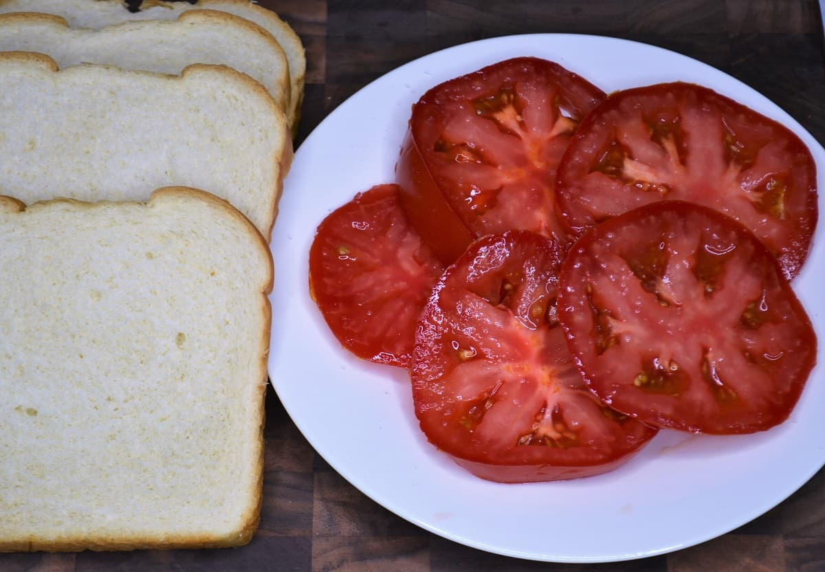 tomato and bread on a board