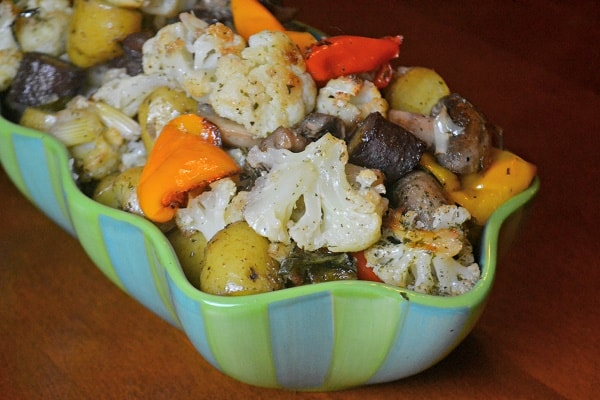 bowl of oven roasted cauliflower, peppers and mushrooms
