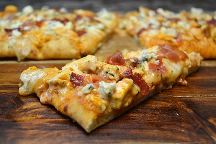 A slice of Buffalo Chicken Flatbread with Bacon