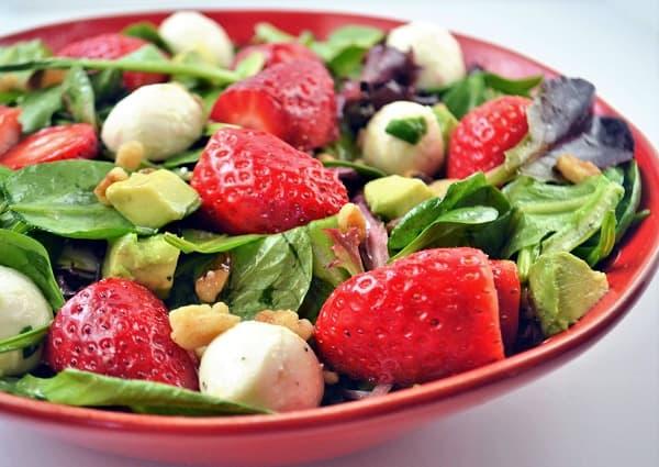 a bowl of fresh strawberry avocado salad