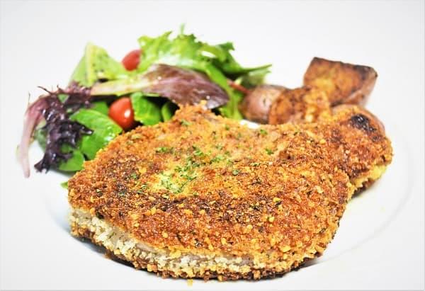 Panko Parmesan pork Chops and salad on a plate