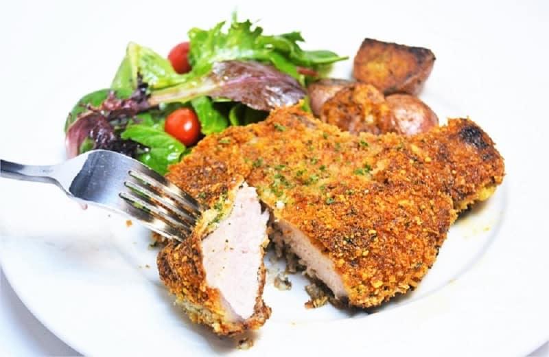 Panko Parmesaan Pork Chop dinneron a plate