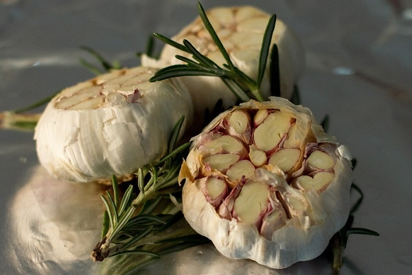 Garlic gets put on foil as it is ready to be roasted.