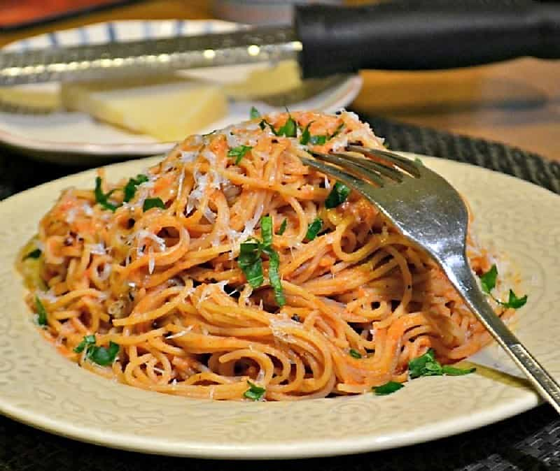 A beautiful plate of pasta with blush sauce.