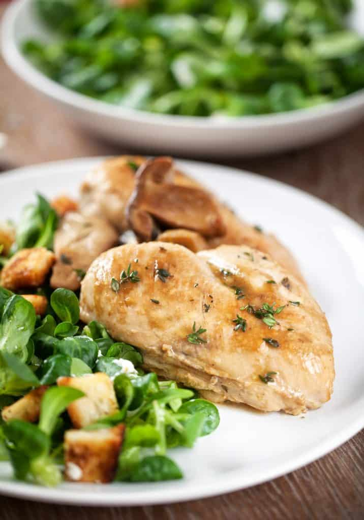 A dinner plate including roaster slow cooker chicken and salad.