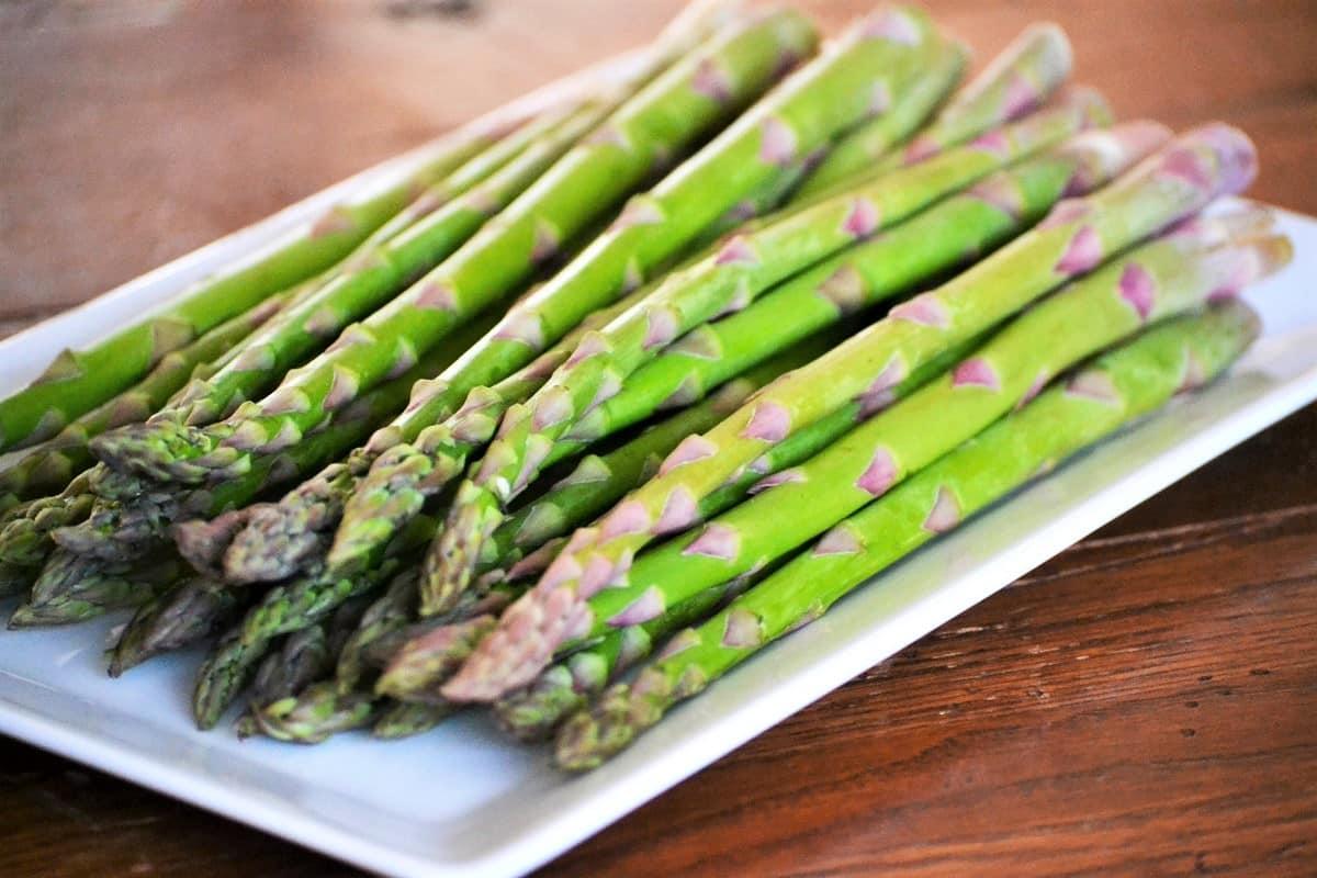 a plate of fresh asparagus