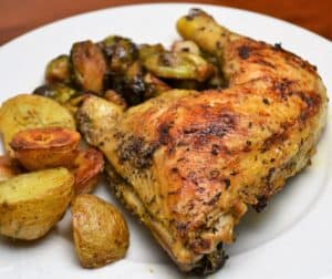 plate of chicken and potatoes