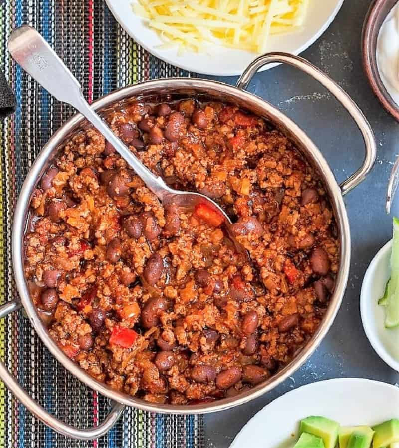 pot of chili and toppings