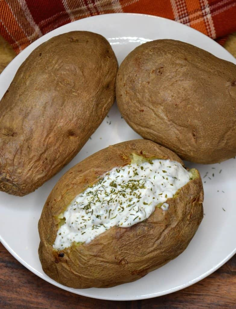 air fryer baked potatoes on a plate