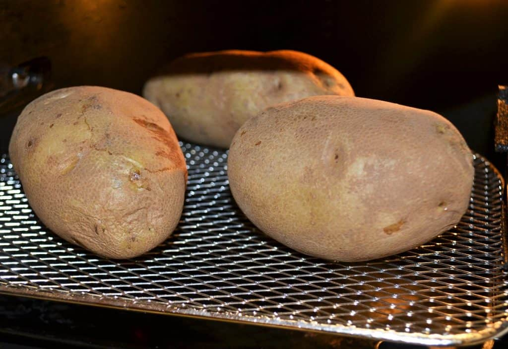 potatoes being cooked in an air fryer