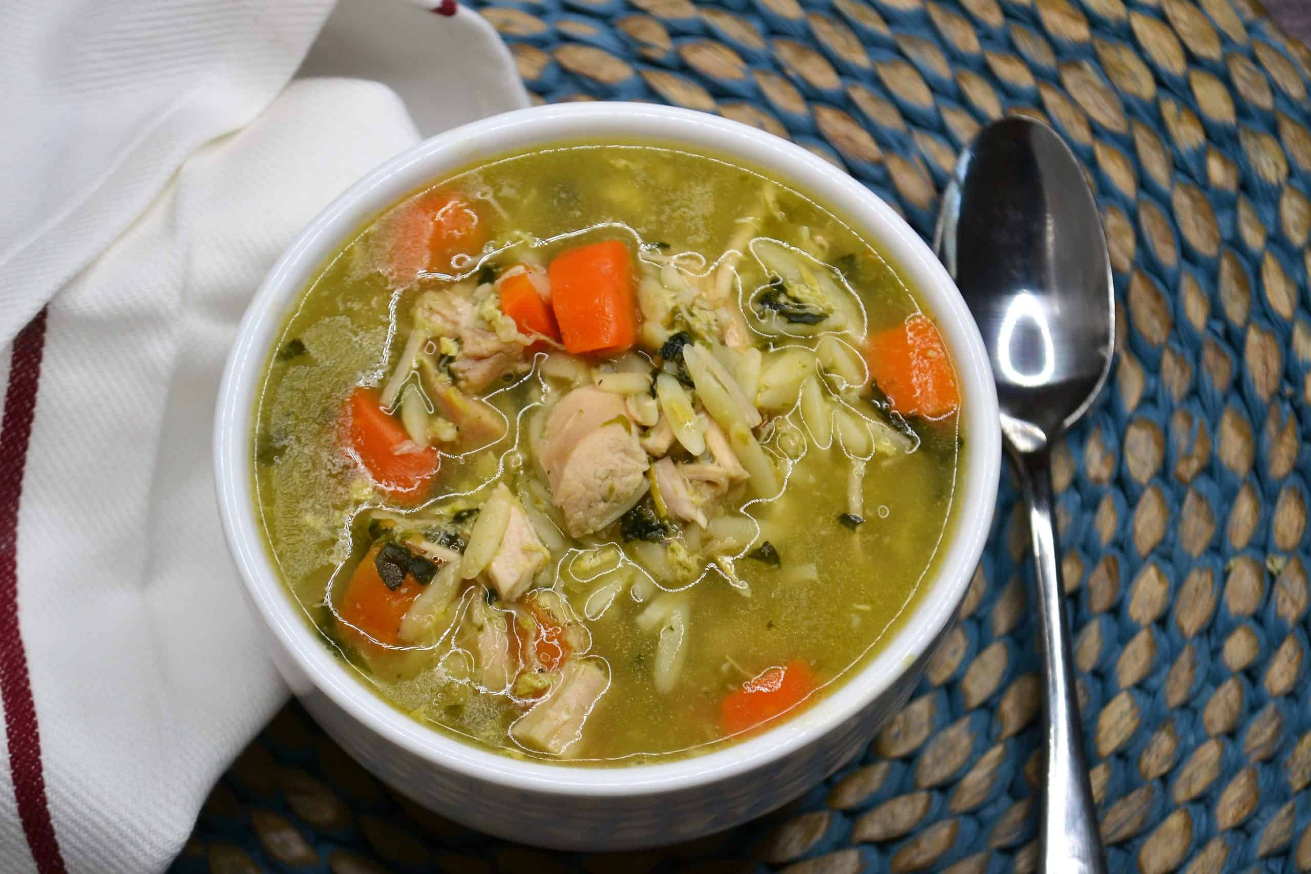 a bowl of orzo soup with leftover turkey