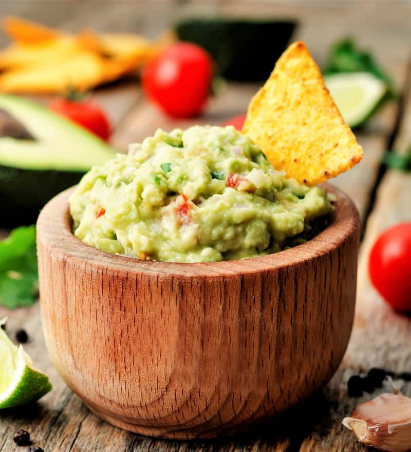 Serve authentic guacamole in a wooden bowl with chips and you have a great party appetizer.