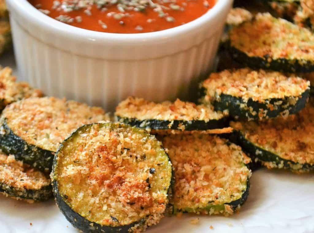 crispy breaded zucchini with a side of marinara sauce