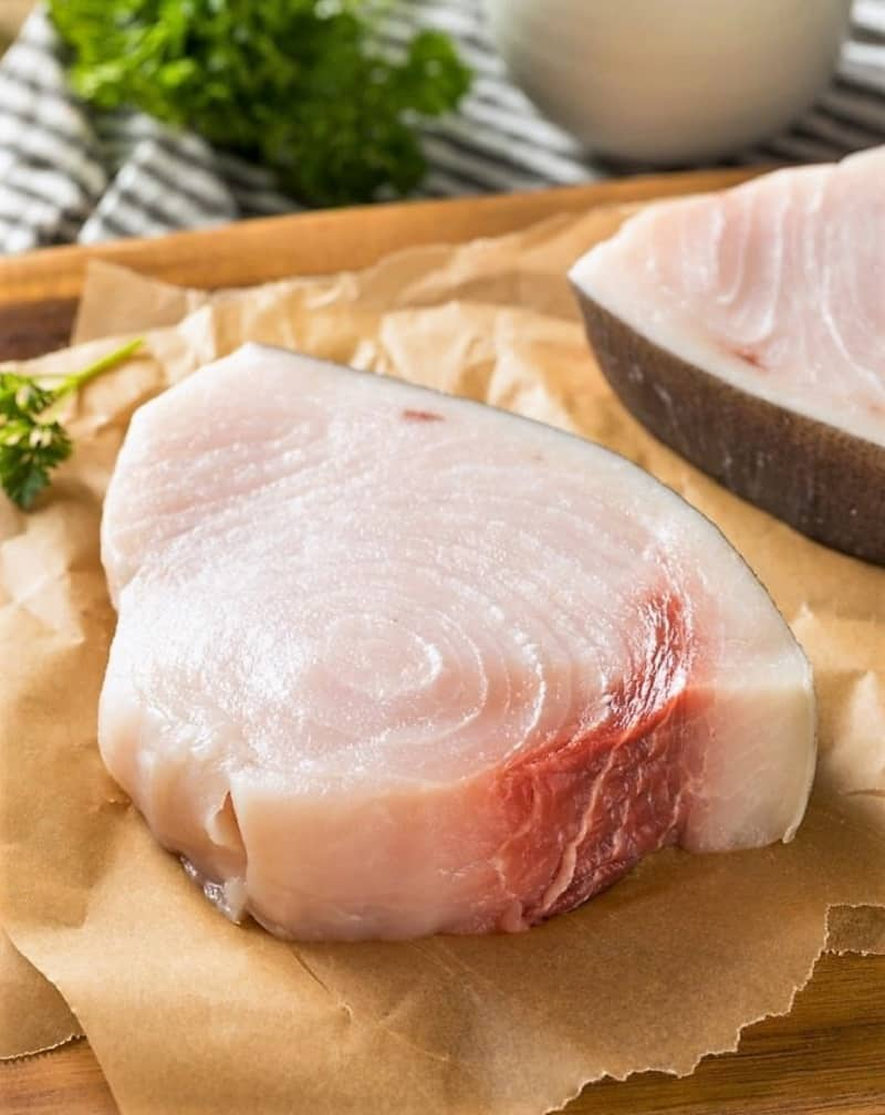 Fresh swordfish steaks should be white with a slight area of red.