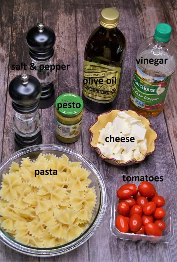 Ingredients needed for caprese pasta salad with pesto