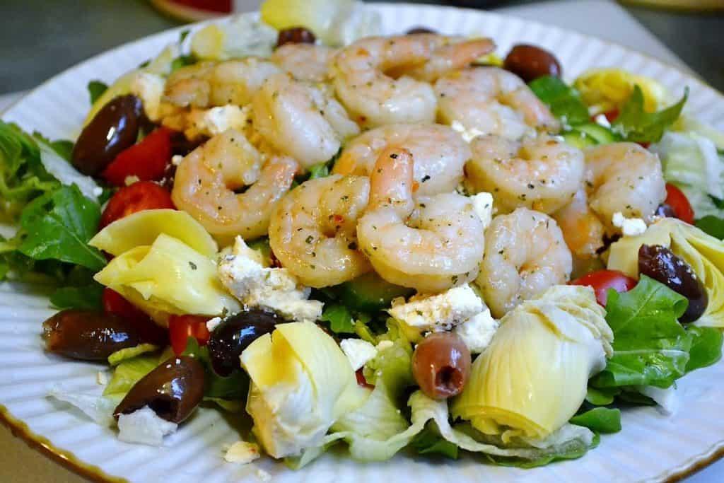 Greek shrimp salad on a plate.