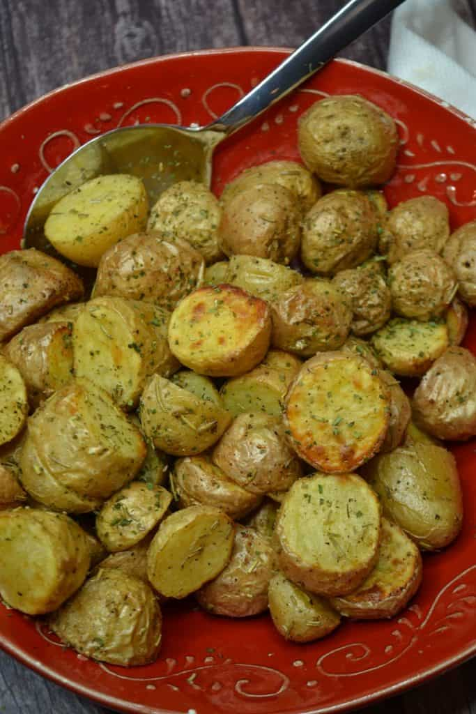 a bowl of roasted baby potatoes
