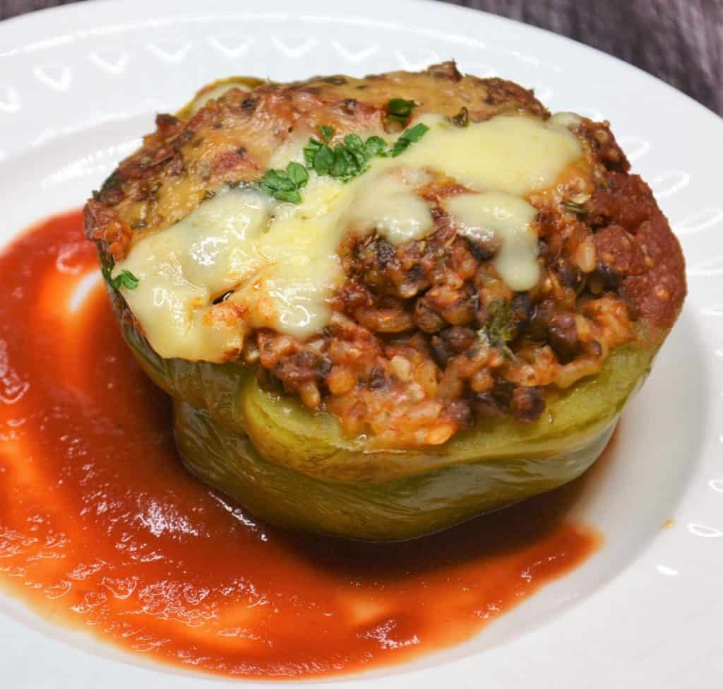 green stuffed pepper with melted cheese on top