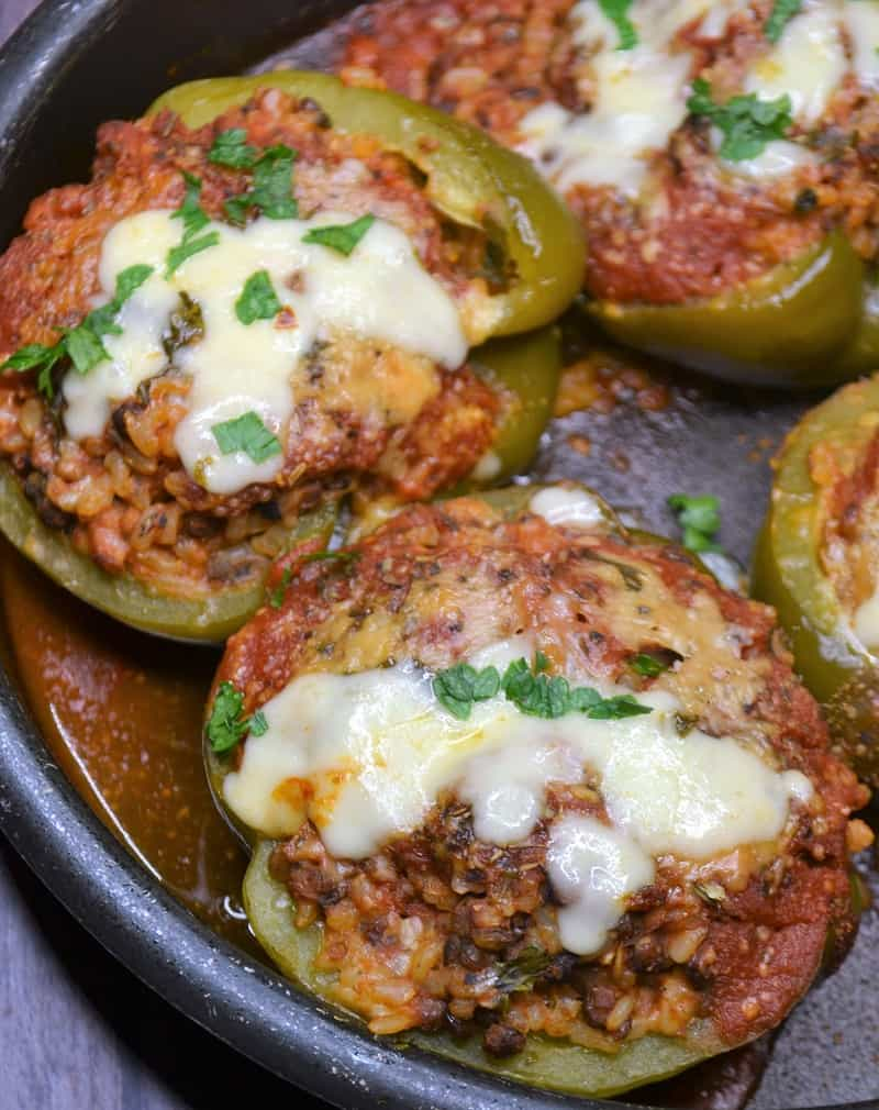Vegetarian Stuffed peppers with lentils, rice and asiago cheese
