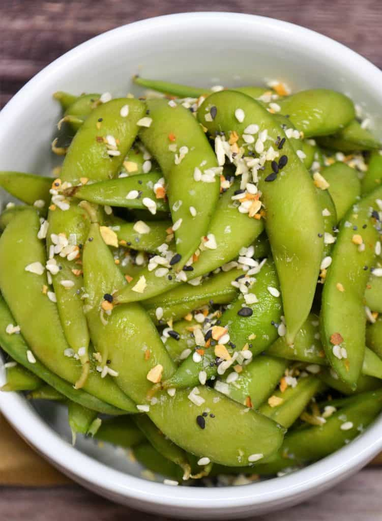 close up of a bowl of steamed edamame